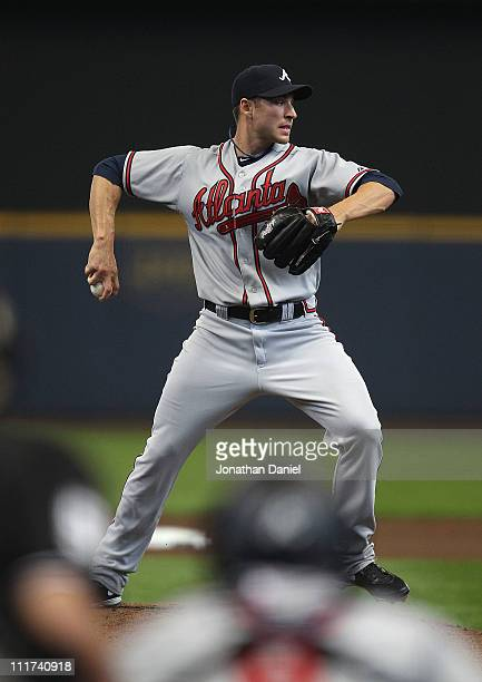 Starting pitcher Brandon Beachy of the Atlanta Braves throws to 1st base against the Milwaukee Brewers during the home opener at Miller Park on April...