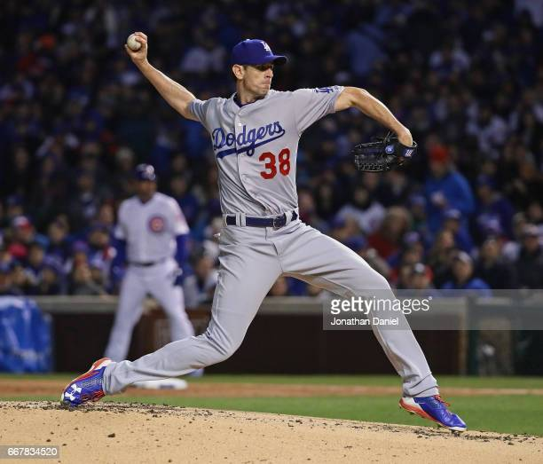 Starting pitcher Brandon McCarthy of the Los Angeles Dodgers delivers the ball against the Chicago Cubs at Wrigley Field on April 12 2017 in Chicago...