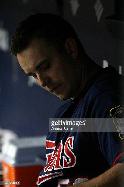 Starting pitcher Brian Duensing of the Minnesota Twins sits in the dugout dejected after he was taken out of the game against the New York Yankees...
