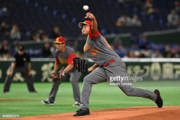 Starting Pitcher Bruce Chen of China throws in the bottom of the first inning during the World Baseball Classic Pool B Game Two between China and...