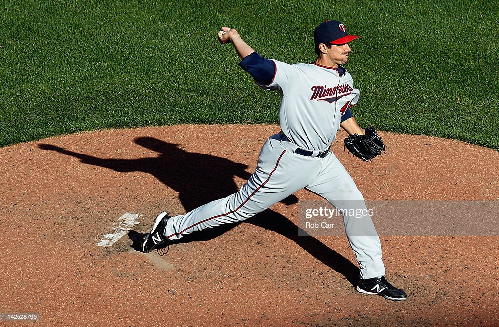 Starting pitcher Carl Pavano #48 of the Minnesota Twins throws to a Baltimore Orioles batter during the sixth inning of opening day at Oriole Park at Camden Yards on April 6, 2012 in Baltimore, Maryland.