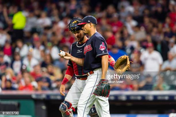 Starting pitcher Carlos Carrasco of the Cleveland Indians and catcher Yan Gomes walk off the field after the end of the top of the first inning...