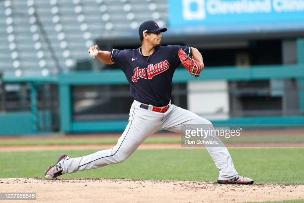 Starting pitcher Carlos Carrasco of the Cleveland Indians delivers in the second inning of an intrasquad game during summer workouts at Progressive...