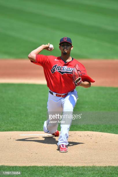 Starting pitcher Carlos Carrasco of the Cleveland Indians pitches during the first inning against the Kansas City Royals at Progressive Field on July...