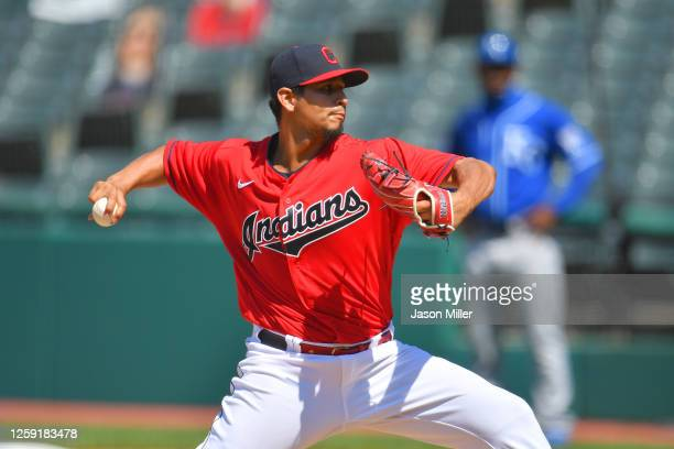 Starting pitcher Carlos Carrasco of the Cleveland Indians pitches during the seventh inning against the Kansas City Royals at Progressive Field on...