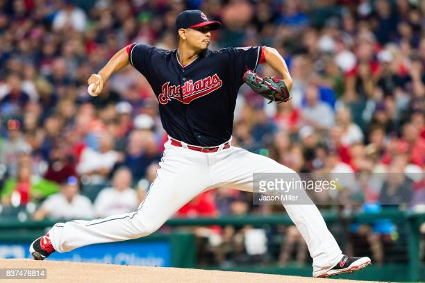 Starting pitcher Carlos Carrasco of the Cleveland Indians pitches during the first inning against the Boston Red Sox at Progressive Field on August...