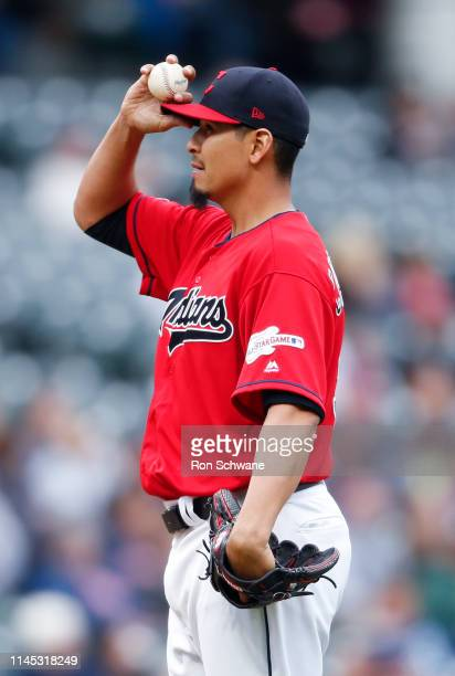 Starting pitcher Carlos Carrasco of the Cleveland Indians reacts after giving up a solo home run to Matt Olson of the Oakland Athletics during the...