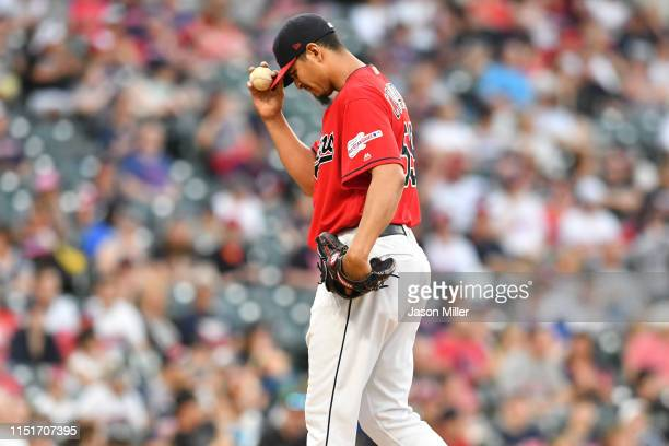 Starting pitcher Carlos Carrasco of the Cleveland Indians reacts after giving up a two run homer during the fifth inning Tampa Bay Rays at...