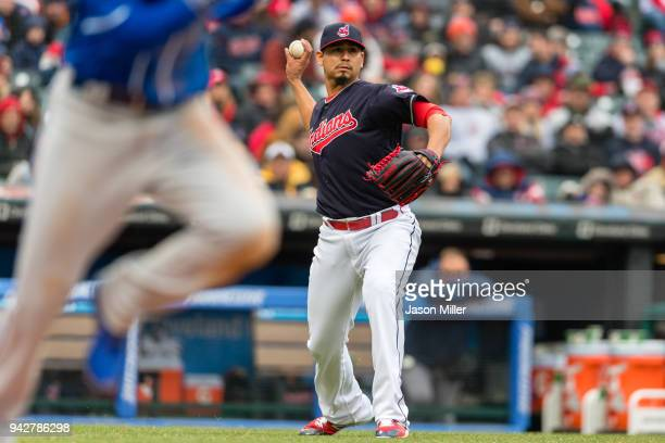 Starting pitcher Carlos Carrasco of the Cleveland Indians throws out Whit Merrifield of the Kansas City Royals on a sacrifice bunt during the sixth...