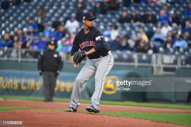 Starting pitcher Carlos Carrasco of the Cleveland Indians throws against the Kansas City Royals at Kauffman Stadium on April 12 2019 in Kansas City...