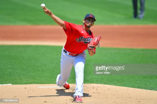 Starting pitcher Carlos Carrasco of the Cleveland Indians warms up during the first inning against the Kansas City Royals at Progressive Field on...