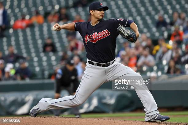 Starting pitcher Carlos Carrasco of the Cleveland Indians works the first inning against the Baltimore Orioles at Oriole Park at Camden Yards on...