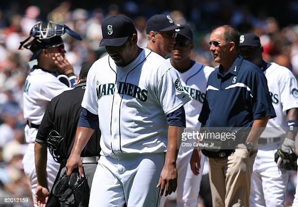 Starting pitcher Carlos Silva of the Seattle Mariners is removed from the game with a back injury in the fourth inning against the Cleveland Indians...
