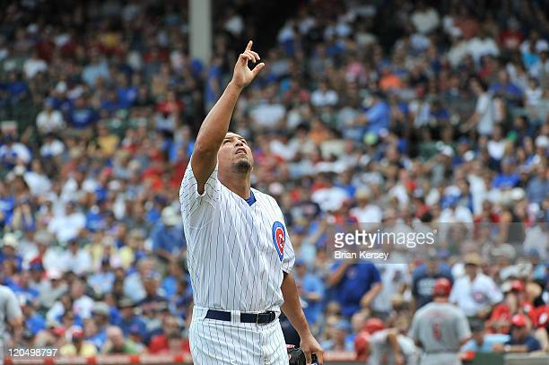Starting pitcher Carlos Zambrano of the Chicago Cubs points to the sky after finishing the sixth inning against the Cincinnati Reds at Wrigley Field...
