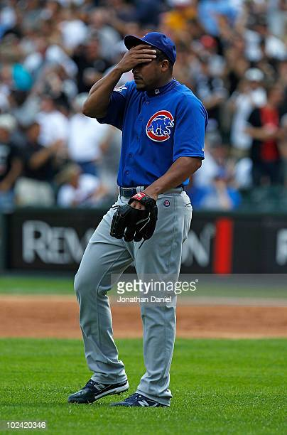 Starting pitcher Carlos Zambrano of the Chicago Cubs reacts after giving up a threerun home run in the 1st inning to Carlos Quentin of the Chicago...
