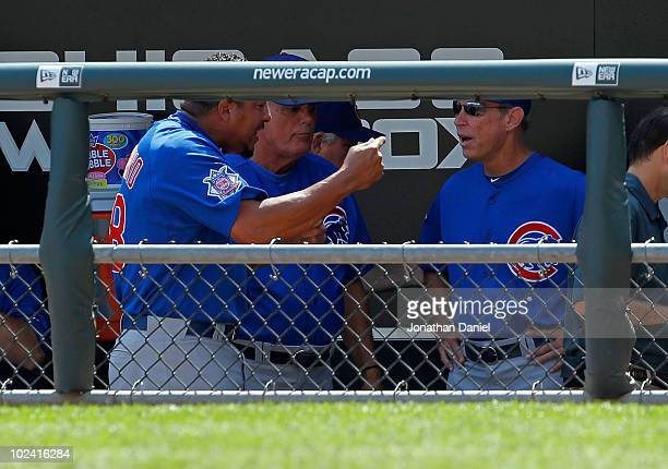Starting pitcher Carlos Zambrano of the Chicago Cubs yells at manager Lou Pinella and bench coach Alan Trammell after giving up four runs in the 1st...
