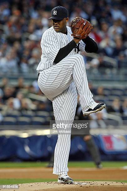 Starting pitcher CC Sabathia of the New York Yankees deals against the Minnesota Twins in Game One of the ALDS during the 2009 MLB Playoffs at Yankee...