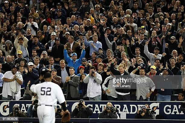 Starting pitcher CC Sabathia of the New York Yankees gets a standing ovation from the crowd after being pulled out of the game in the seventh inning...