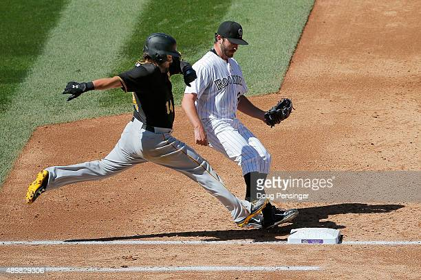 Starting pitcher Chad Bettis of the Colorado Rockies gets a put out on Jaff Decker of the Pittsburgh Pirates at first after first baseman Wilin...