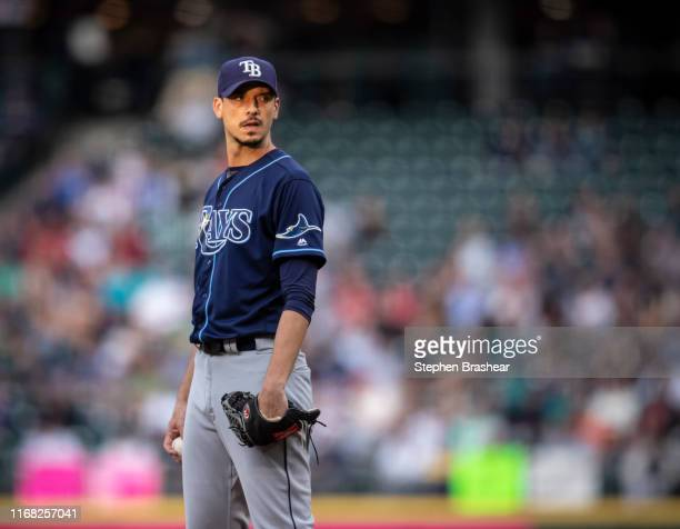Starting pitcher Charlie Morton of the Tampa Bay Rays looks toward home plate for signs during a game Seattle Mariners at TMobile Park on August 10...