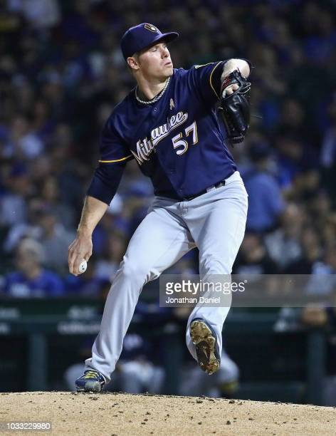 Starting pitcher Chase Anderson of the Milwaukee Brewers delivers the ball against the Chicago Cubs at Wrigley Field on September 12 2018 in Chicago...