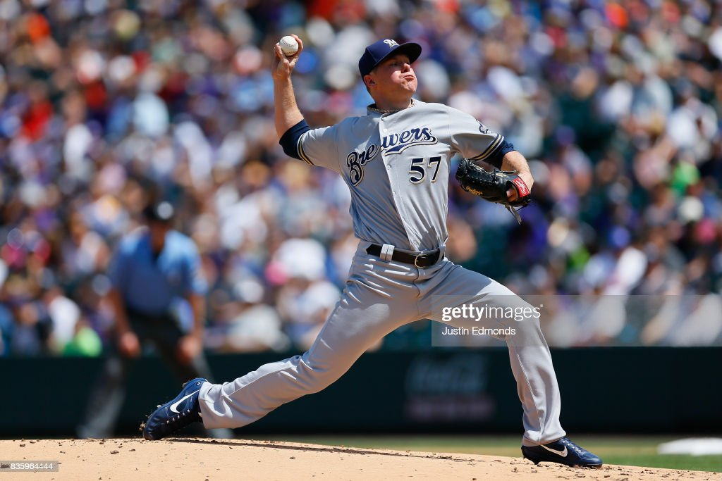 Starting pitcher Chase Anderson #57 of the Milwaukee Brewers delivers to home plate during the first inning during the game against the Colorado Rockies at Coors Field on August 20, 2017 in Denver, Colorado.