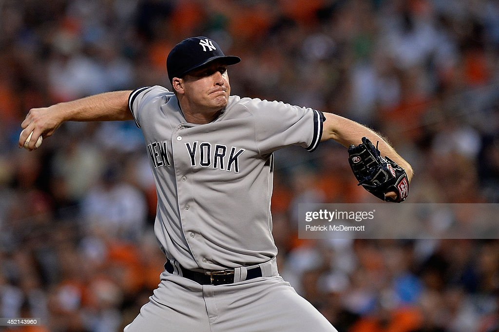 Starting pitcher Chase Whitley #39 of the New York Yankees throws a pitch in the first inning during a game against the Baltimore Orioes at Oriole Park at Camden Yards on July 13, 2014 in Baltimore, Maryland.