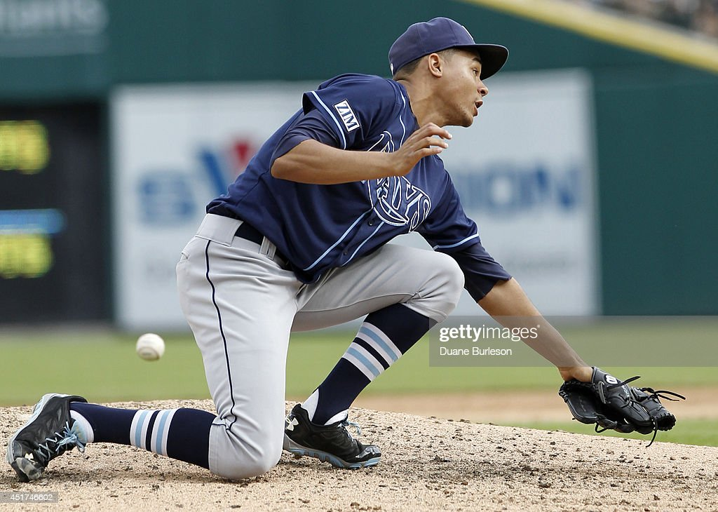 Starting pitcher Chris Archer #22 of the Tampa Bay Rays can't make the catch on a grounder hit up the middle by Miguel Cabrera of the Detroit Tigers during the sixth inning at Comerica Park on July 5, 2014 in Detroit, Michigan. Second baseman Logan Forsythe of the Tampa Bay Rays fielded the ball and threw out Cabrera at first base.