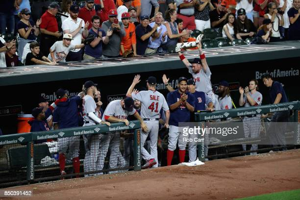 Starting pitcher Chris Sale of the Boston Red Sox celebrates after striking out Ryan Flaherty of the Baltimore Orioles for his 300th strike out of...