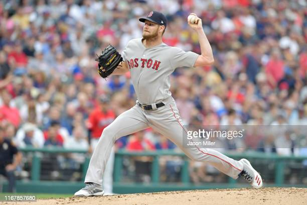 Starting pitcher Chris Sale of the Boston Red Sox pitches during the first inning against the Cleveland Indians at Progressive Field on August 13...