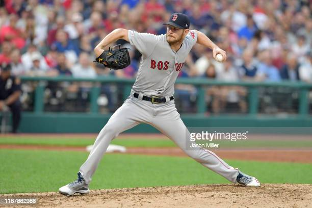 Starting pitcher Chris Sale of the Boston Red Sox throws his 2000th career strike out to Oscar Mercado of the Cleveland Indians to end the third...