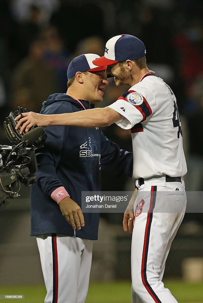 Starting pitcher Chris Sale #49 of the Chicago White Sox hugs jake Peavy #44 after his one-hit shutout of the Los Angeles Angels of Anaheim at U.S. Cellular Field on May 12, 2013 in Chicago, Illinois. The White Sox defeated the Angels 3-0.