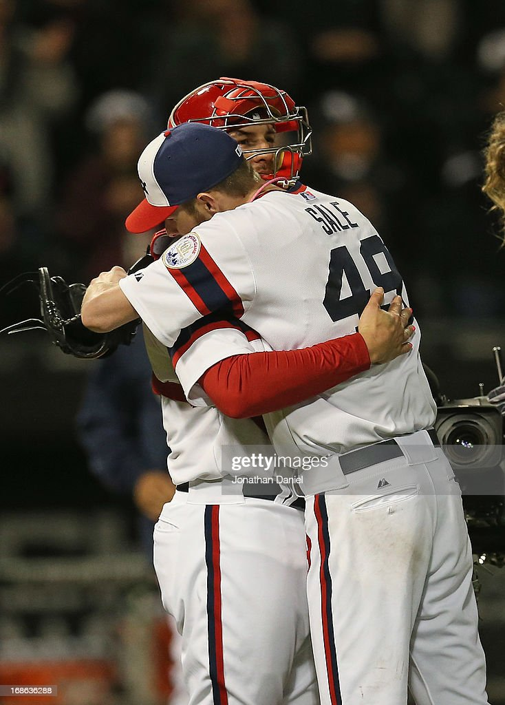 Starting pitcher Chris Sale #49 of the Chicago White Sox hugs Tyler Flowers #21 after his one-hit shutout of the Los Angeles Angels of Anaheim at U.S. Cellular Field on May 12, 2013 in Chicago, Illinois. The White Sox defeated the Angels 3-0.