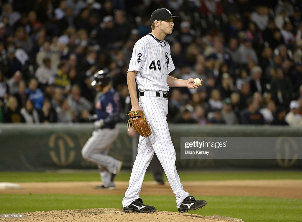 Starting pitcher Chris Sale #49 of the Chicago White Sox stands on the mound after giving up a two-run home run to Russ Canzler #4 of the Cleveland Indians scoring Carlos Santana #41during the sixth inning at U.S. Cellular Field on September 24, 2012 in Chicago, Illinois.