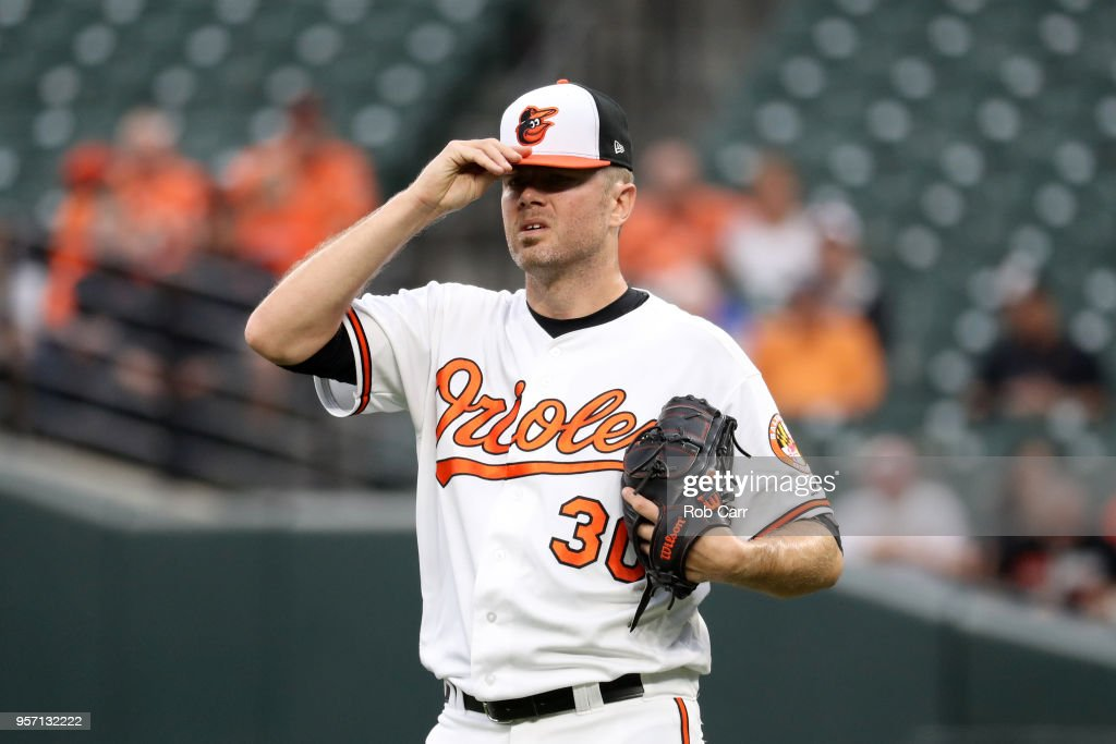 Starting pitcher Chris Tillman #30 of the Baltimore Orioles reacts after giving up a grand slam to the Kansas City Royals in the first inning at Oriole Park at Camden Yards on May 10, 2018 in Baltimore, Maryland.