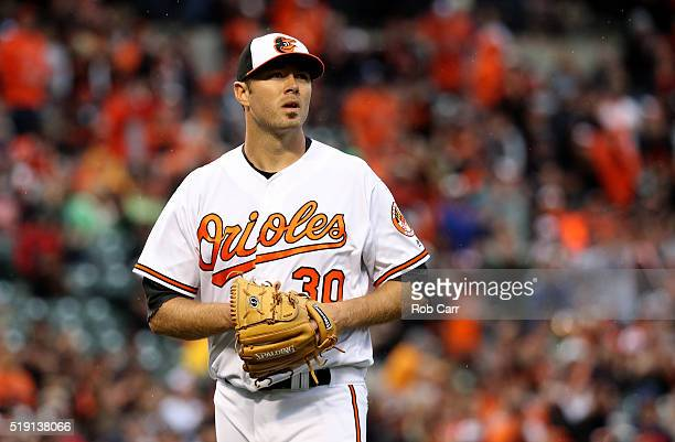 Starting pitcher Chris Tillman of the Baltimore Orioles walks off the mound after retiring the side against the Minnesota Twins in the second inning...