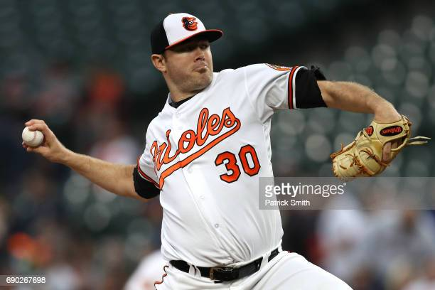 Starting pitcher Chris Tillman of the Baltimore Orioles works the first inning against the New York Yankees at Oriole Park at Camden Yards on May 30...