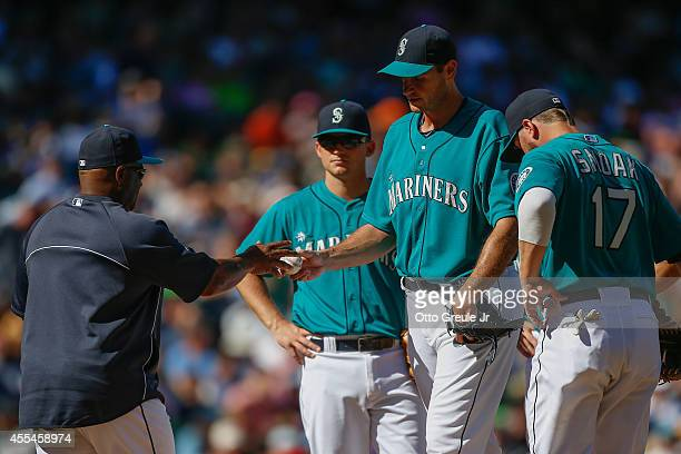 Starting pitcher Chris Young of the Seattle Mariners is removed from the game by manager Lloyd McClendon in the seventh inning against the Oakland...