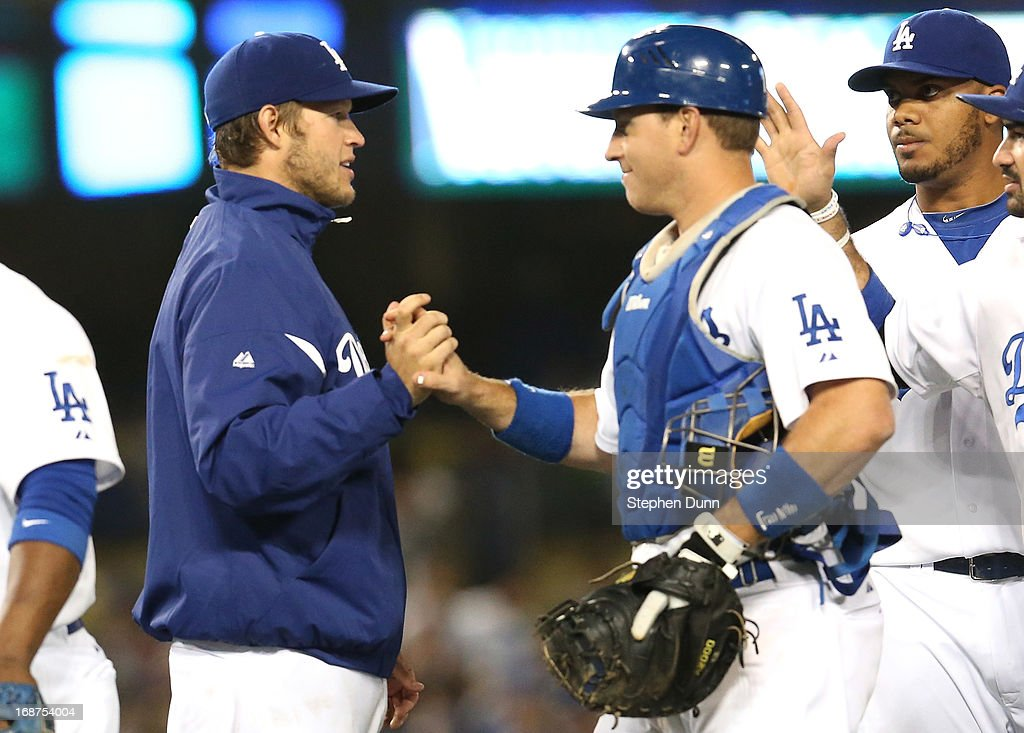 Starting pitcher Clayton Kershaw #22 (L) and catcher A.J. Ellis #17 of the Los Angeles Dodgers celebrate after the game against the Washington Nationals at Dodger Stadium on May 14, 2013 in Los Angeles, California. The Dodgers won 2-0.