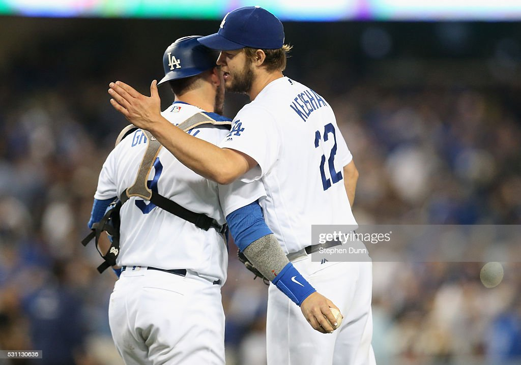 Starting pitcher Clayton Kershaw #22 and catcher Yasmani Grandal #9 of the Los Angeles Dodgers celebrate after the final out of the game against the New York Mets at Dodger Stadium on May 12, 2016 in Los Angeles, California. Kershaw threw a complete game shutout along with 13 strikeouts as the Dodgers won 5-0.