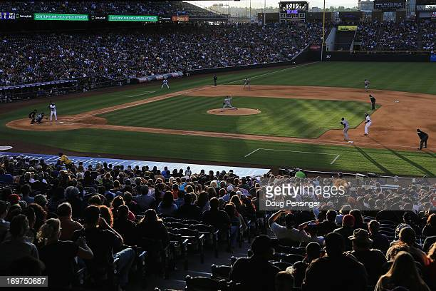 Starting pitcher Clayton Kershaw of the Los Angeles Dodgers delivers against the Colorado Rockies at Coors Field on May 31 2013 in Denver Colorado...