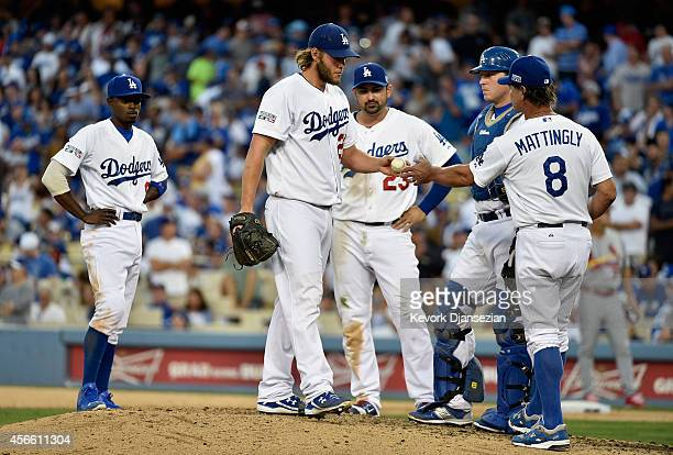 Starting pitcher Clayton Kershaw of the Los Angeles Dodgers gives the ball to manager Don Mattingly after he was relieved during the seventh inning...