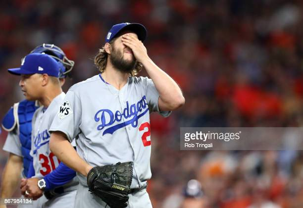 Starting pitcher Clayton Kershaw of the Los Angeles Dodgers is taken out of the game in the fifth inning of Game 5 of the 2017 World Series against...