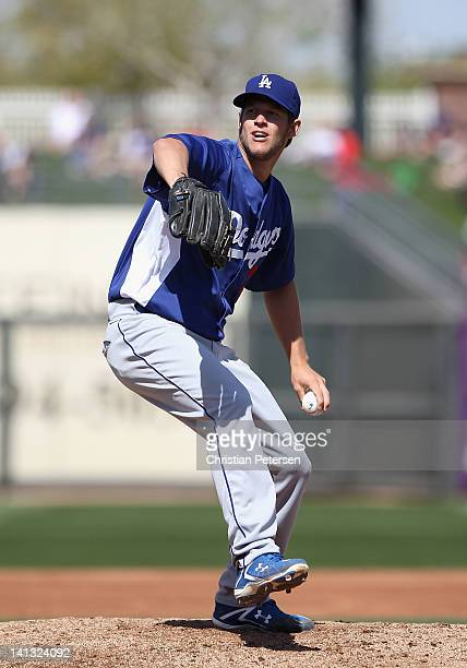 Starting pitcher Clayton Kershaw of the Los Angeles Dodgers pitches against the Texas Rangers during the spring training game at Surprise Stadium on...