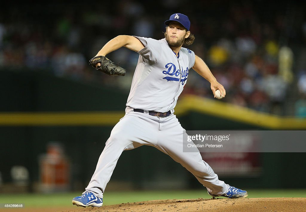 Starting pitcher Clayton Kershaw #22 of the Los Angeles Dodgers pitches against the Arizona Diamondbacks during the MLB game at Chase Field on August 27, 2014 in Phoenix, Arizona.