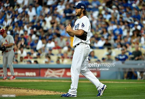 Starting pitcher Clayton Kershaw of the Los Angeles Dodgers reacts after giving up three base hits to the St Louis Cardinals in the seventh inning of...