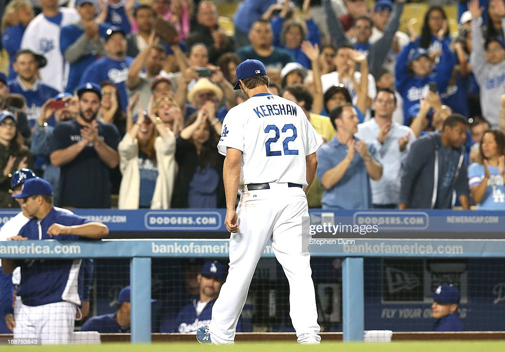Starting pitcher Clayton Kershaw #22 of the Los Angeles Dodgers returns to the dugout as he is reilieved in the ninth after pitching 8 2/3 shutout innings against the Washington Nationals at Dodger Stadium on May 14, 2013 in Los Angeles, California. The Dodgers won 2-0.