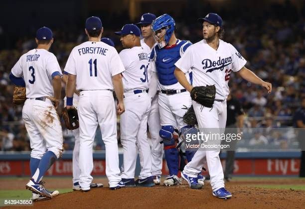Starting pitcher Clayton Kershaw of the Los Angeles Dodgers right looks to the outfield as he leaves the game in the fourth inning during the MLB...