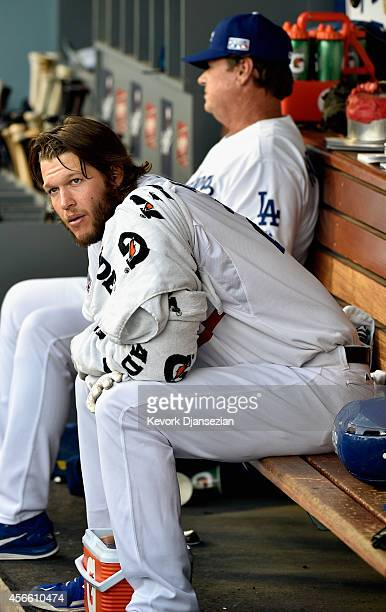 Starting pitcher Clayton Kershaw of the Los Angeles Dodgers sits in the dugout in Game One of the National League Division Series against the St...