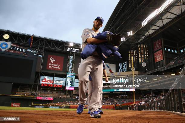 Starting pitcher Clayton Kershaw of the Los Angeles Dodgers walks to the dugout before the MLB game against the Arizona Diamondbacks at Chase Field...